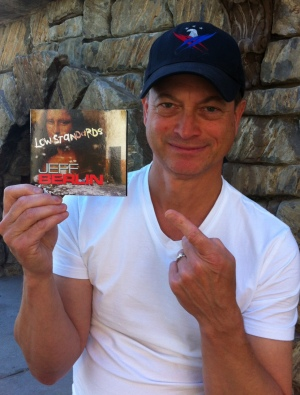 gary sinise holding jeff berlin cd